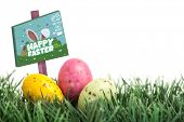 image of laying eggs  - Easter egg hunt sign against small easter eggs nestled in the grass - JPG
