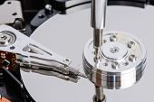 stock photo of driver  - Disassemble Hard disk drive with star shape screw driver - JPG
