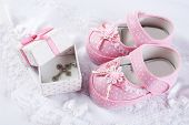 stock photo of christening  - Baby shoe and cross for Christening - JPG