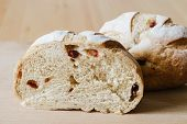 stock photo of whole-grain  - fresh whole grain bread with cranberry on wooden background - JPG