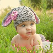 pic of baby easter  - Easter bunny sweet baby in green grass - JPG