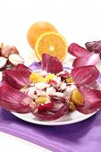 stock photo of chicory  - red chicory salad with orange slices and dressing - JPG