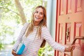 foto of leaving  - Young Woman Leaving Home For Work With Packed Lunch - JPG