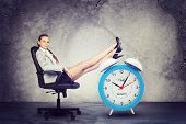 stock photo of big-foot  - Businesswoman sits in chair - JPG