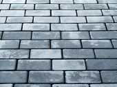 stock photo of paving stone  - Urban road is paved with blocks of stone cobblestone walkway selective focus - JPG