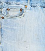 picture of denim jeans  - Front pocket light blue denim jeans fragment as a background composition - JPG
