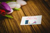 pic of wheelbarrow  - Chick with wheelbarrow of hearts against tulips on desk - JPG