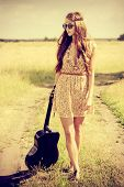 pic of hippy  - Romantic girl travelling with her guitar - JPG