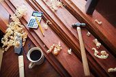 foto of work bench  - Wood working or carpentry scene with coffee - JPG