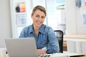 image of stressless  - Businesswoman working from home on laptop - JPG