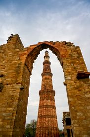 picture of qutub minar  - Archway framing the famous landmark the Qutub minar in Delhi - JPG