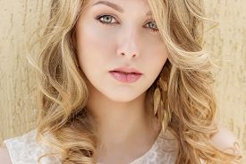 stock photo of big lips  - Portrait of a beautiful sexy smiling happy girl with big full lips with blond hair in a white dress on a sunny bright day  - JPG