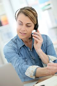 stock photo of stressless  - Active woman teleworking from home - JPG