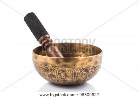 Traditional Nepali singing bowl isolated in white