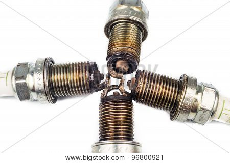 Close up of used spark plugs with focus on the electrode with deposits
