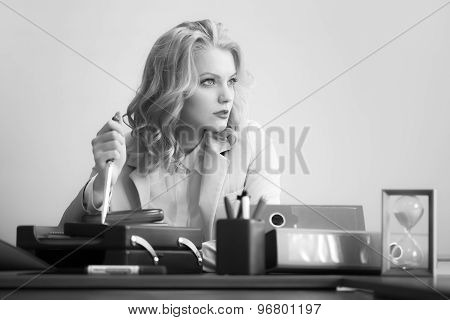 Pensive Woman With Paper Knife In Office