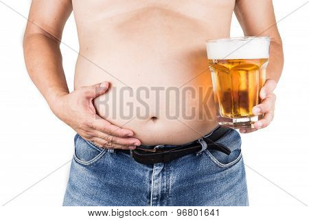 Obese man with big belly holding a glass of refreshing cold beer