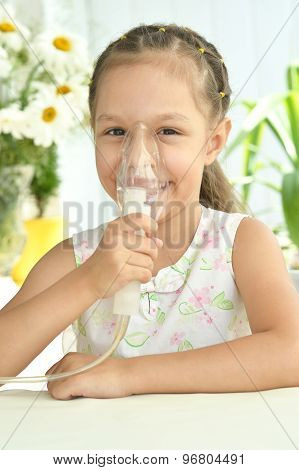 Little girl with  mask for inhalation