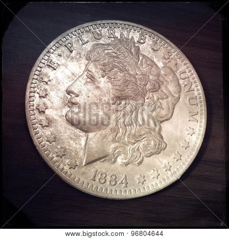 Close up of an imitation Morgan Silver Dollar coin with an Instagram style filter