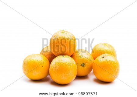 Stack of fresh and juicy naval oranges isolated in white