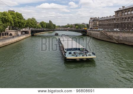 Barge At River Seine Downtown In Paris, France