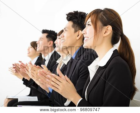 Business People Sitting In A Row And Applauding