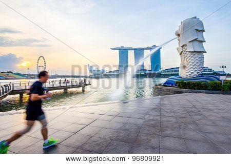Singapore Skyline And Merlion With Sunrise
