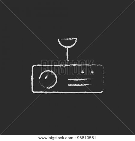 Vintage radio with analog dials and antenna hand drawn in chalk on a blackboard vector white icon on a black background