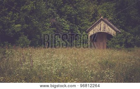 vintage photo of an abandoned wooden house