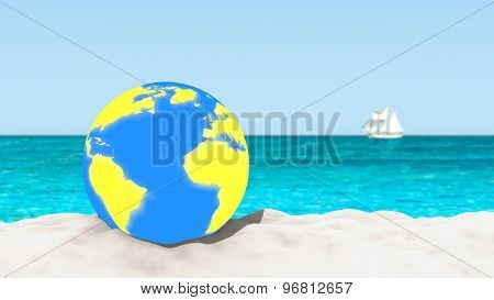 Ball with a world map pattern on a sandy beach with a blurred background.