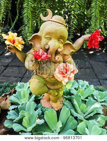 Ganesh statue holding hibiscus flowers, Thailand