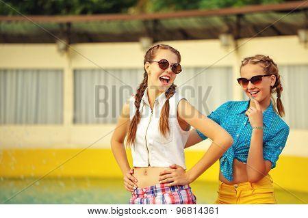 Teen Girl In Sunglasses Laugh.