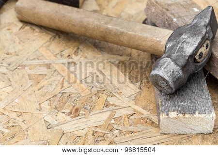 Hammer On A Wooden Background