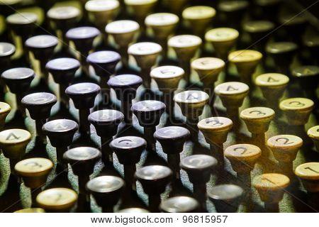 Close Up Photo Of Antique Typewriter Keys On Background.
