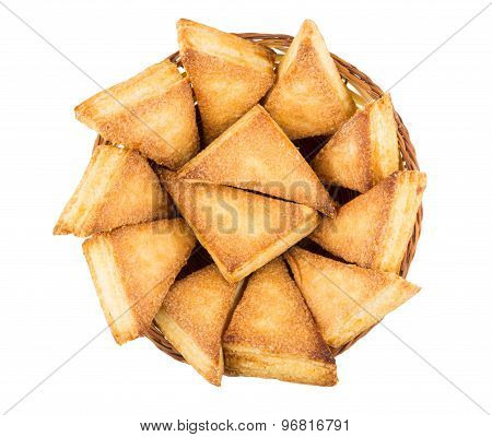 Sweet Puff Pastries In Wicker Basket Isolated On White