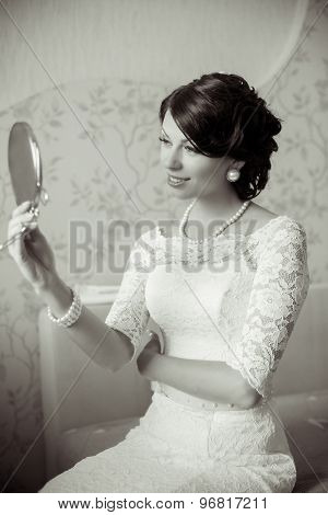Young bride looking in the mirror