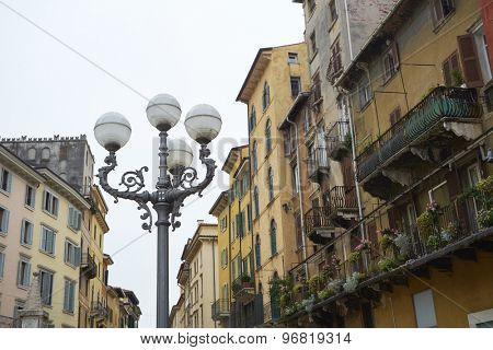 VERONA, ITALY - JULY 13: Low angle shot of lamp post in Piazza delle Erbe. July 13, 2015 in Verona.