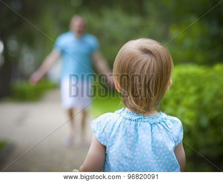 Happy Young Father With Little Daughter Outdoors In Summer Park