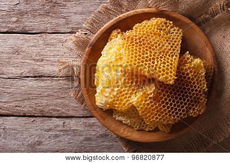 Golden Honeycombs On A Wooden Plate. Horizontal Top View