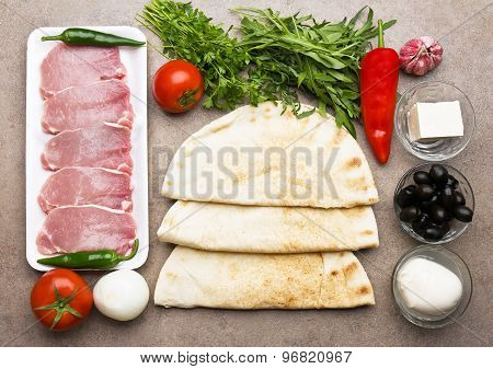 Ingredients for cooking quesadilla.