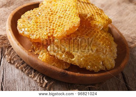 Fresh Honey Combs On A Wooden Plate Close-up. Horizontal