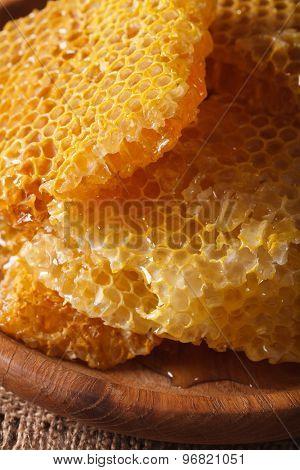 Fresh Golden Honeycomb On Wooden Plate Macro. Vertical