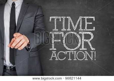 Time for action on blackboard with businessman