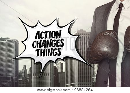 Action changes things text with businessman wearing boxing gloves