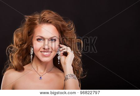 portrait of a beautiful smiling woman with luxury accessories. fashion model
