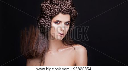 Beautiful fashion woman model with a creative pigtails hairstyling.