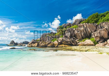 Beautifully shaped granite boulders and a perfect white sand at Grand Anse, La Digue island, Seychelles