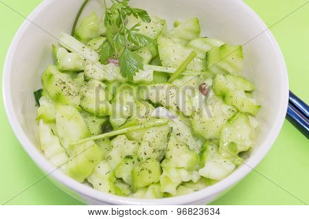 Salad With Cucumber And Marrow Squash With Parsley Onion And Oregano Next To Japanese Chopsticks On