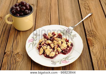 Piece Of Delicious Homemade Cherry Crumble With Fork In White Plate With Pink Carnations And Yellow