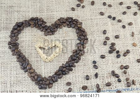 Heart Shape Made Entirely Out Of Coffee Grains Placed On A Coffee Bag